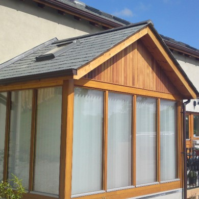 Ken O'Brien Carpentry and Building - Wood sun room with slate roof