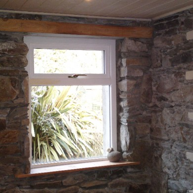 Ken O'Brien Carpentry and Building - Wood window cut into stone wall