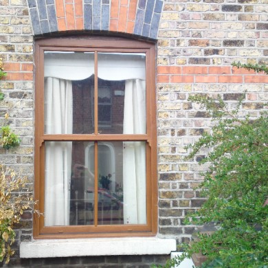 Ken O'Brien Carpentry and Building - Woodgrain up and down sash window