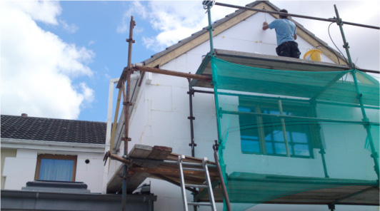 External Insulation - a house being wrapped in expanded polystyrene